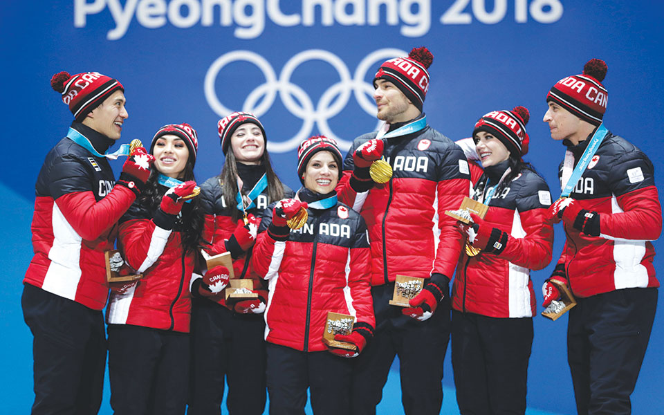 Figure skating team claimed Canada's first gold medal of the games