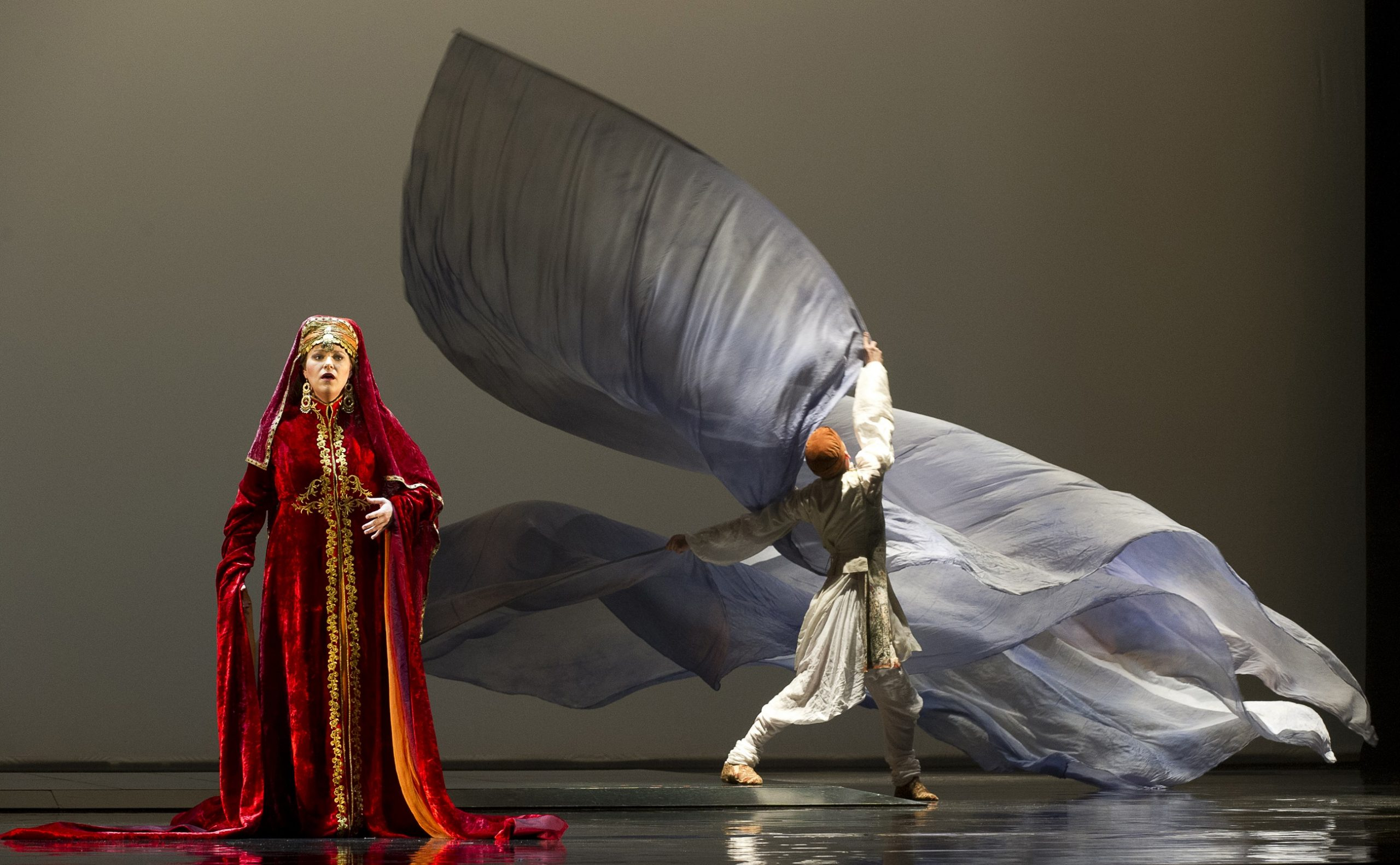 Erin Wall as Clémence and acrobat Ted Sikström in a scene from the Canadian Opera Company production of Love from Afar, 2012. Conductor Johannes Debus, original production by Daniele Finzi Pasca, set designer Jean Rabasse, costume designer Kevin Pollard, and lighting designers Daniele Finzi Pasca and Alexis Bowles. Photo: Chris Hutcheson
