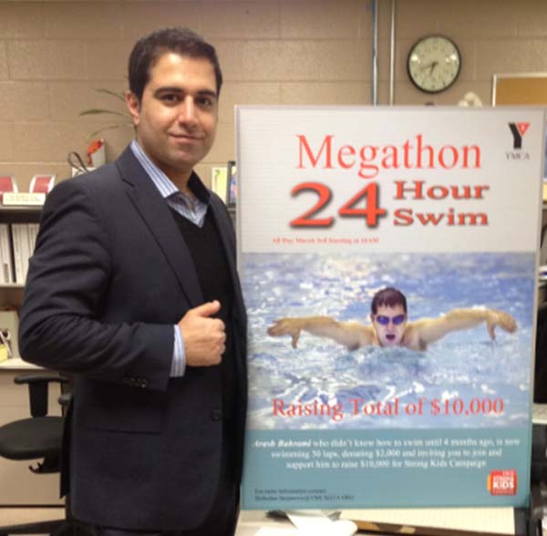 """Arash Bahrami is a successful Iranian-Canadian Real Estate Agent. He has three Master's degrees; two in Engineering and one MBA Bahrami had a life-long fear of swimming after a childhood accident nearly caused him to drown. Today he is competing in a 50-lap """"Megathon"""" to help raise funds for the North York YMCA. Bahrami's goal is to raise $10,000 for the North York YMCA by March 3rd. He has so far raised $3,600."""