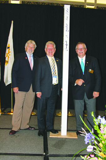 "Richmond Hill Mayor David Barrow is shown receiving the ""Peace Pole"" by members of the Richmond Hill Rotary Club on Oct. 17, 2012"