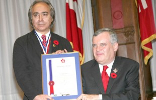 """Salam Toronto Editor-in-Chief, Mohsen Taghavi, receiving the award from Ontario Lieutenant Governor Mr. David C. Onley."" Mr. Mohsen Taghavi is a professional journalist with over 32 years of experience and worked as an editor with the major daily newspapers in Iran from 1980 to 1997. He migrated to Canada in 1997 and after working with other ethnic publications, moved on to launch Canada's first Persian-English weekly newspaper, Salam Toronto, in 2000. On March 31, 2007, the Ontario Community Newspapers Association (OCNA) elected Mr. Taghavi as a Board Member. He was the first OCNA Board Member representing a newspaper published in a language other than English or Friench. Mr. Taghavi is a honourary member of the Board of Directors with the Council. He sees Canada as a role model and, with his editorials, encourages his readers to integrate into the Canadian mainstream. As a journalist, he takes every opportunity to promote and reflect the Canadian values."