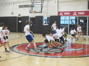 The kids going through the basketball drills on their first class.