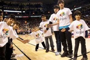 As part of the festivities, Iranian children wearing Tirgan shirts had the privilege of walking on the basketball court during halftime.