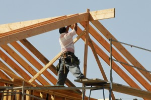 Image: A construction worker works on the framework for a single family home currently under construction in Los Angeles