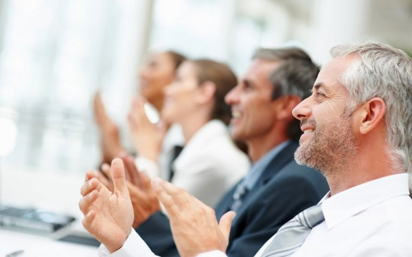 photo credit: Group of happy business people clapping their hands - license
