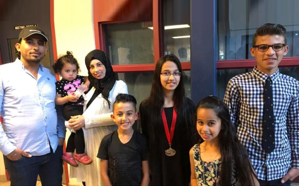 Five of the Barho children with their parents, in an undated photo posted to Facebook by the Halifax mosque the family attended. (Ummah Masjid/Facebook)